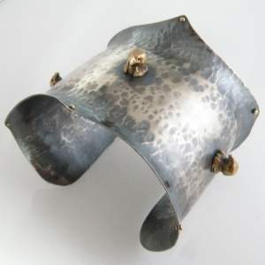 "women's hand forged and oxidized sterling silver cuff with three bronze ""vulture"" head accents. 2.5"" wide. Add to cart: $TK"