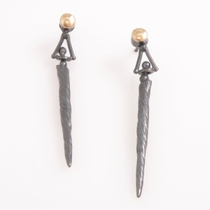 """Cast """"narwhal tusk"""" earrings, finished with 14k gold accents. Available in polished sterling silver or oxidized sterling silver."""